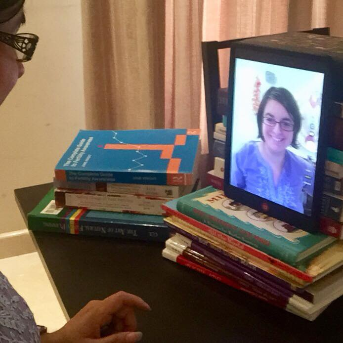 Tami Stroud improvised with a stacked book setup for her Facebook Live interview about Fertility Awareness. :: Victoria Thorogood: Health Coach Interviews Me About Exploring the Fertility Awareness Method | Starry-Eyed Pragmatist